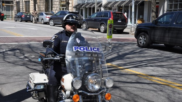 "Decatur Police Officer ""Motorcycle"" Bob, a man who tickets many a speeder in the city. Photo by Dan Whisenhunt."
