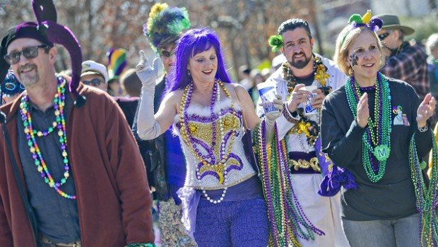 Kate Galatas (left) and her husband Blane march down Oakview Road. Photo by Jonathan Phillips