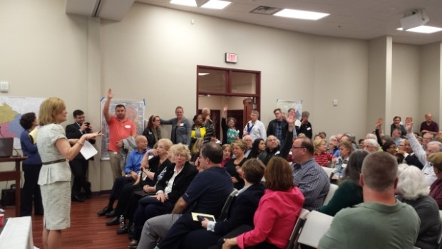 State Senator Elena Parent takes a poll of the crowd at a cityhood and annexation town hall. Photo by Dena Mellick