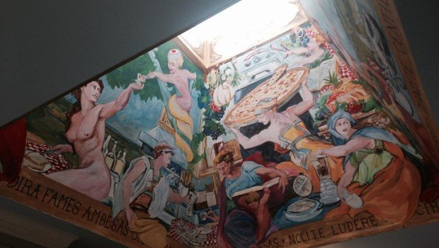 Campy fauvist mural in skylit ceiling of Oakhurst Castle. Photo by Jemille Williams