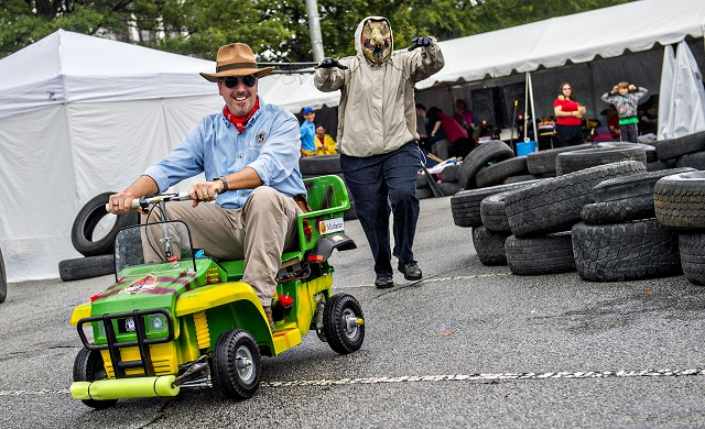 Jay Dellinger (left) is chased by Selena Fulford as they compete in the Moxie Challenge during the Atlanta Maker Faire in Decatur on Saturday.  Photo: Jonathan Phillips