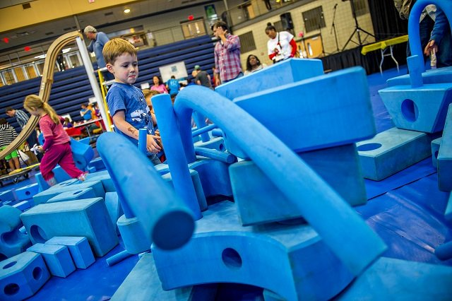 Harrison Taylor (center) plays in foam blocks during the Atlanta Maker Faire in Decatur on Saturday.  Photo: Jonathan Phillips