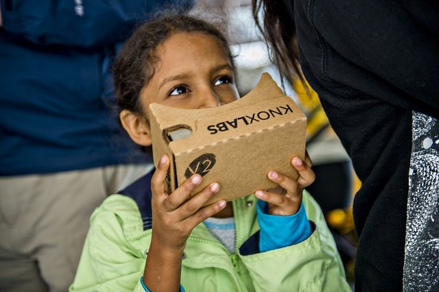 Mila Lorick plays around with Google Cardboard during the Atlanta Maker Faire in Decatur on Saturday. Photo: Jonathan Phillips