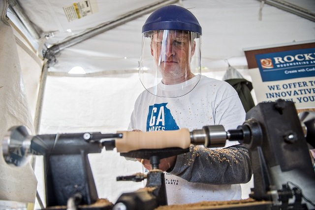 Dan Cary uses a mini lathe to cut into a piece of wood during the Atlanta Maker Faire in Decatur on Saturday. Photo: Jonathan Phillips