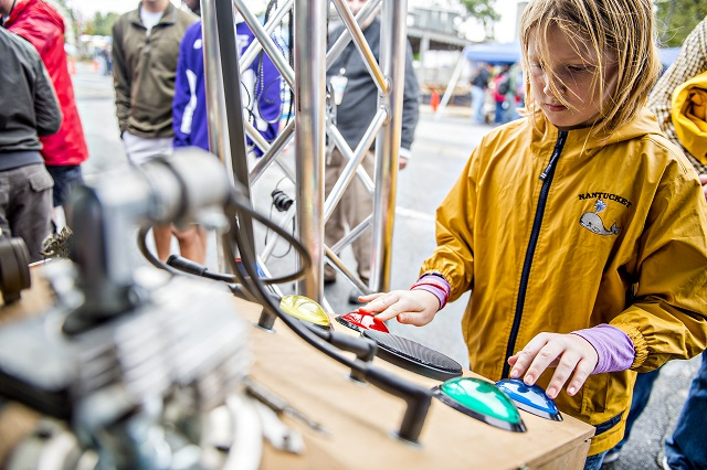 Charlotte Fee plays a homemade game of Simon during the Atlanta Maker Faire in Decatur on Saturday. Photo: Jonathan Phillips