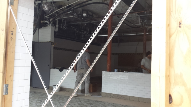 A white-tiled divider also has been installed in the Waffle House under construction in Decatur. Photo by Dena Mellick