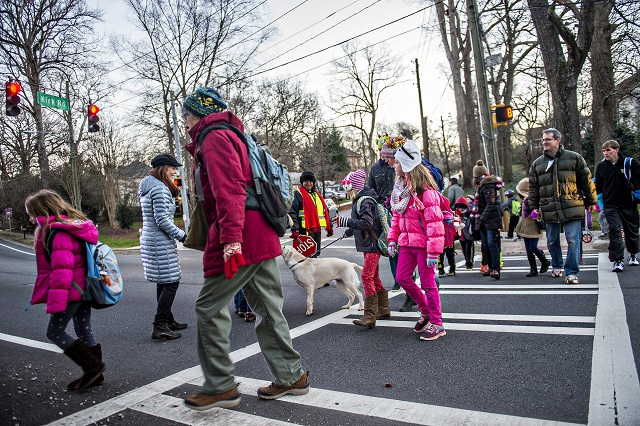 A large group of people cross S. Candler St. at Kirk Rd. in Decatur on their way to school during the Big Walk on South Candler event on Wednesday morning. Photo: Jonathan Phillips