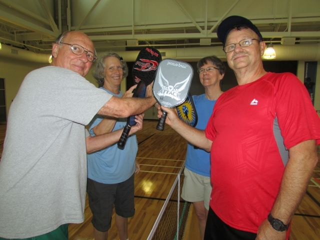 Pickleball players in Decatur hold up their paddles. Photo courtesy of Decatur Active Living/Travis Hudgons