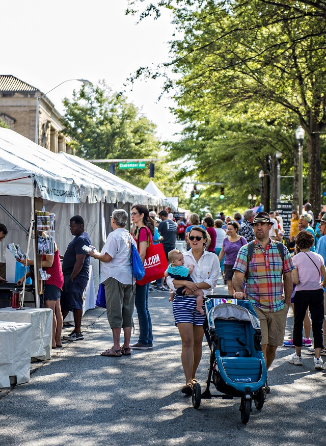 Angus Galloway (right), his wife Amanda and son Lachlan walk past the numerous booths during the Decatur Book Festival on Saturday. Photo: Jonathan Phillips