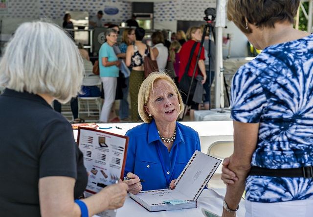 Author Anne Byrn talks to fans as she autographs books during the Decatur Book Festival on Saturday. Photo: Jonathan Phillips