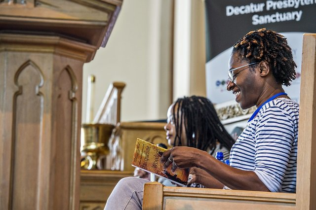 "Author Jacqueline Woodson (right) reads an excerpt from her newest novel ""Another Brooklyn"" during the Decatur Book Festival on Saturday. Photo: Jonathan Phillips"