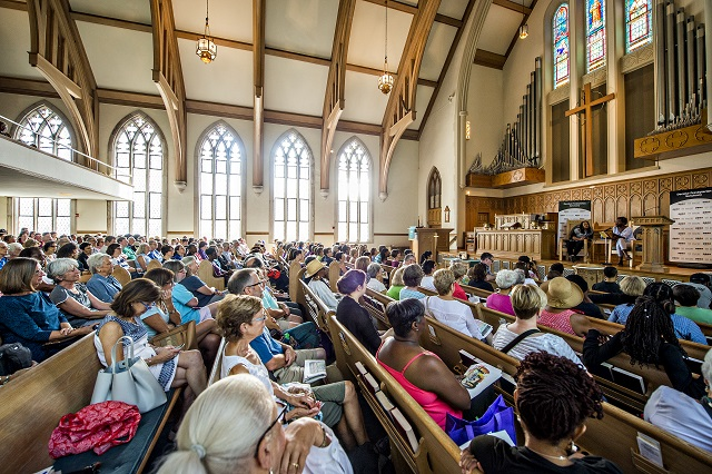 "Hundreds of people sit in the pews of Decatur Presbyterian Church as they listen to author Jacqueline Woodson read an excerpt from her newest novel ""Another Brooklyn"" during the Decatur Book Festival on Saturday. Photo: Jonathan Phillips"